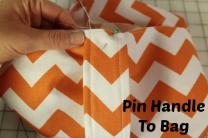 pin handle to bag