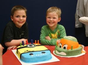 Boys and their cakes.